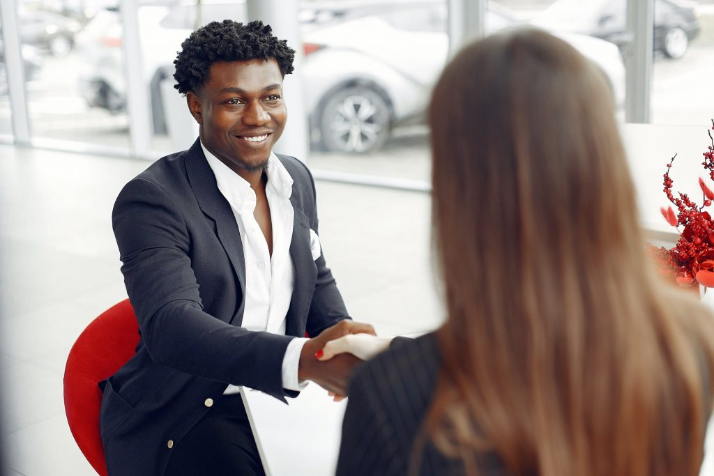 Excited buyer shaking hands