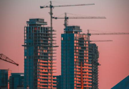 Cranes on skyline